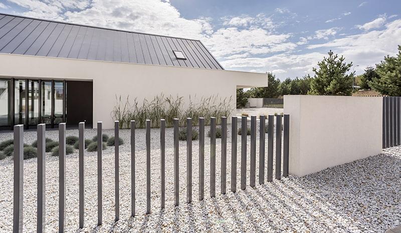 fence-of-spacious-white-house-PKVJF74-min
